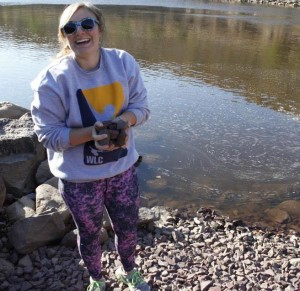 EPCAMR's first Community Relations Outreach Intern, Gabby Zawacki, collecting rock samples down by the Susquehanna River.