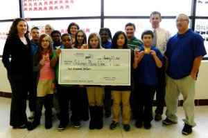Students gather with PPL, EPCAMR, and W-B Area School District at Leo E. Solomon Plains to receive the grant check.
