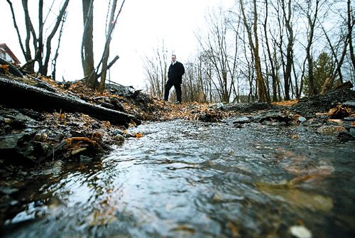 Justin Taylor stands near a water run off on the former Gravity Railroad near an abandoned mine in Carbondale. (Michael J. Mullen)